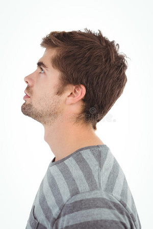 side view serious man looking up against white background 60556668