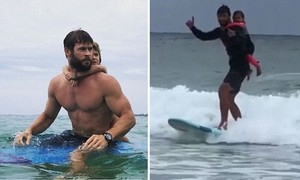 Chris going surfing with daughter India