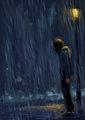 Sad boy in the rain