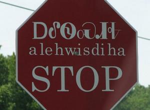 Stop sign in ᏣᎳᎩᏱ (Cherokee)