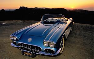 Blue 1959 Corvette sunset in background