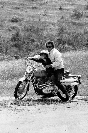 Clint Eastwood takes his son Kyle for a spin on his motorcycle 1973