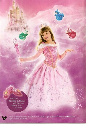 Young Bella Thorne modeling an Aurora/Sleeping Beauty costume