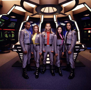 The space rangers on the bridge of the mega ship