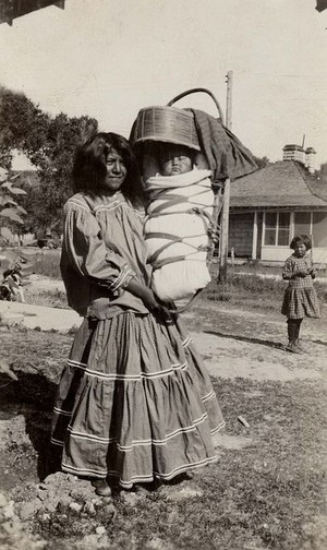 Apache Woman and baby in a Tsoch (Apache Cradle) 1931