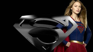 Supergirl and icon 2 Wallpaper