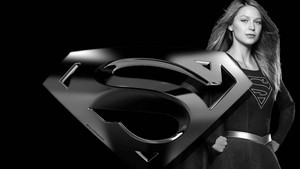 Supergirl and icon 4 wallpaper