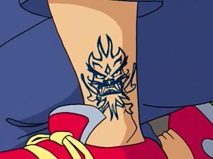 Tarakudo Mark as a tattoo on Jade's leg