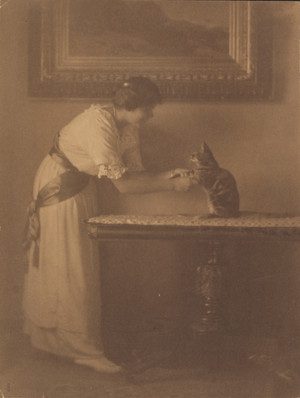 Lady Playing With Her Cat