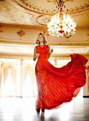 Bade Iscil with a red dress