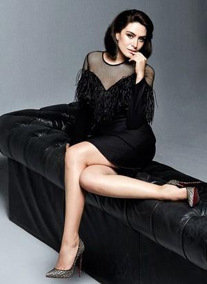 Belcim Bilgin with a black dress