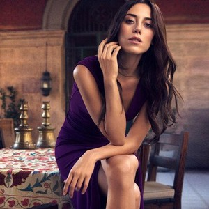 Cansu Dere with a purple dress