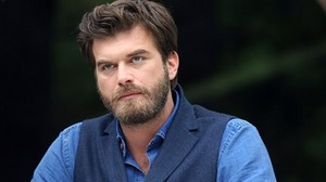 Kivanc Tatlitug with blue clothes