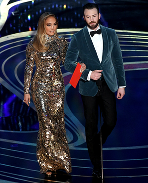 Jennifer Lopez and Chris Evans speak onstage during the 91st Annual Academy Awards February 24, 2014