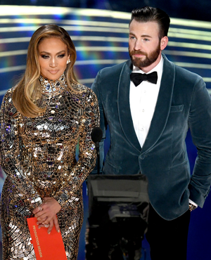 Jennifer Lopez and Chris Evans speak onstage during the 91st Annual Academy Awards February 24, 2019