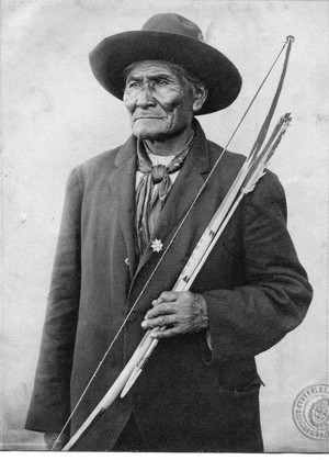 Geronimo (Goyaałé) with traditional Apache bow