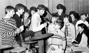 Beatles with their fans