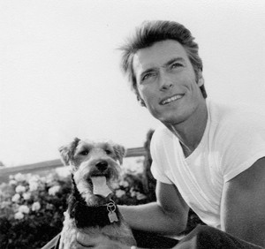 Clint Eastwood photographed with his beloved Airedale terrier (1960)