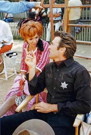 Clint Eastwood w- Arlene Golonka photographed on the set of Hang 'Em High (1967)