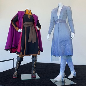 Anna and Elsa costumes at the d23expo
