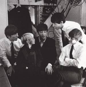 Beatles with a young fan