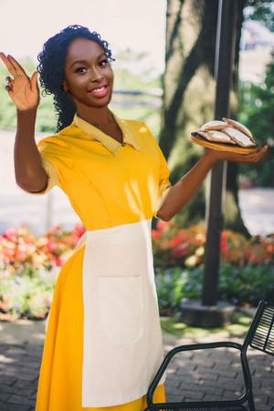 Coco Jones as Tiana (Waitress)