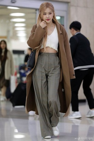 Rose at airport back from Beijing