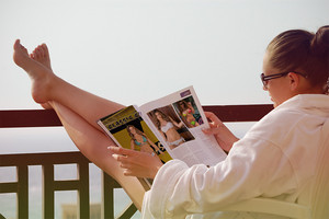 She reading a Allure Magazine