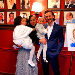 Tom Hiddleston with Zawe Ashton and their onstage daughters at Sardi's in NYC on December 5, 2019