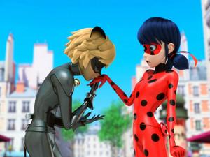 Cat Noir kisses Ladybug's hand