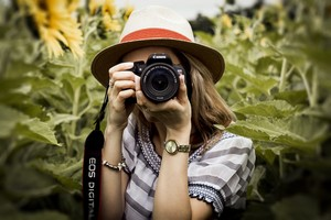 Girl Taking Picture with Camera