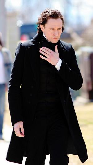 Tom Hiddleston (as Thomas Sharpe on the set of Crimson Peak)