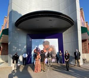 Nikkolas Smith unveiling Chadwick memorial mural in downtown Disney