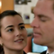 Ziva touches Tony's back and stomach.