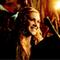 Clarke smiling at Bellamy.
