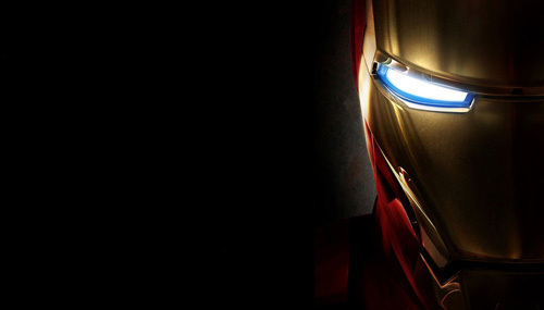 Who physically attacks Iron Man onstage at the Stark Expo?