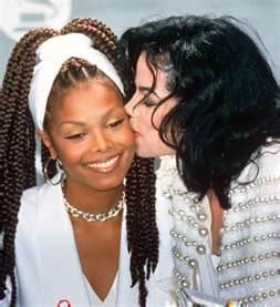 This photo of Michael and younger sister, Janet, was taken at the 1993 Grammy Awards