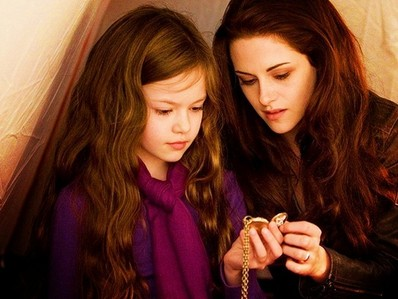 Who is/are in the picture of the Renesmee's necklace?