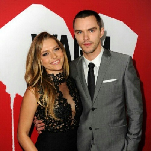 What is the name of the woman on Nicholas Hoult's right?