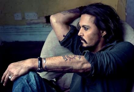 How many tatoos has Johnny Depp got?