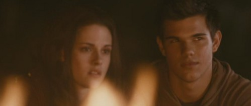 Including Bella and Jake, how many people are in this scene?