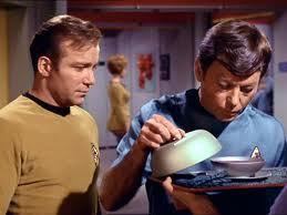 Who's holding the tray with the soup?