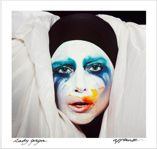On the artwork for 'Applause' Lady Gaga is wearing a white jacket by...