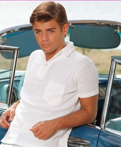 Garret Clayton plays who in Teen Beach Movie?