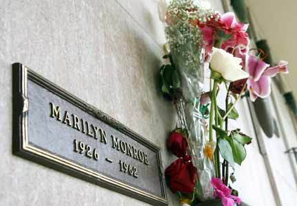 Who owns the burial vault next to Marilyn?