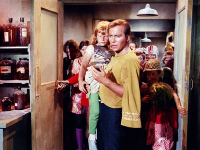 Whose child is William Shatner holding?