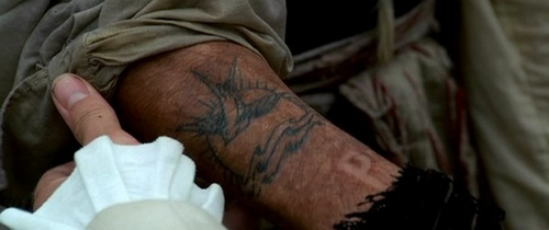 What Is The Name Of The Bird Jack Sparrow Has Tattooed On Hs Arm?