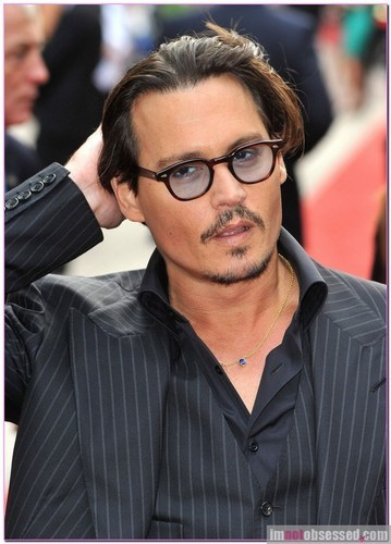 Does Johnny have any body piercings?