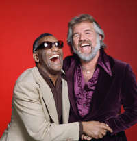"straal, ray Charles and Kenny Rogers were featured vocalists in the 1985 video, ""We Are World"""
