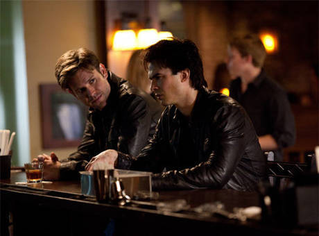 What does Damon say when Alaric punches him in 1x17?
